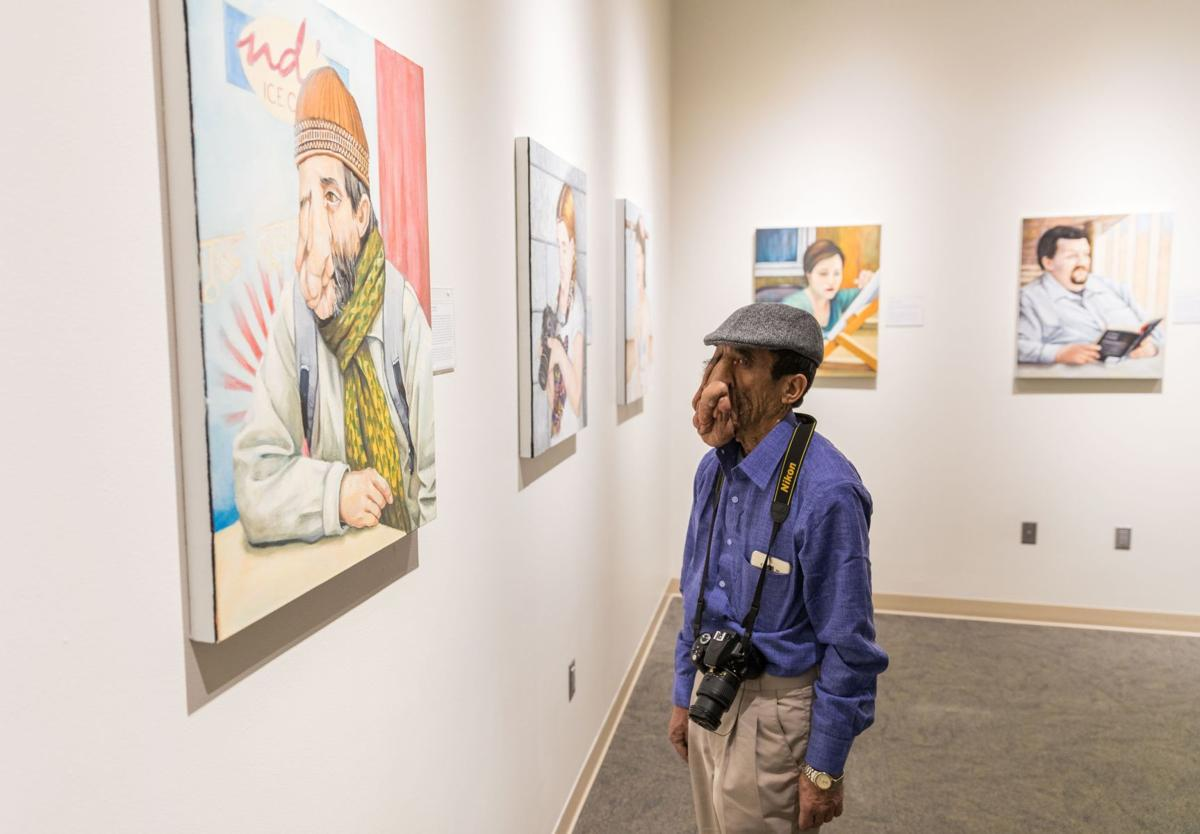 Disfigured Nepali man, in U.S. for surgery, comes to Norfolk to see his portrait